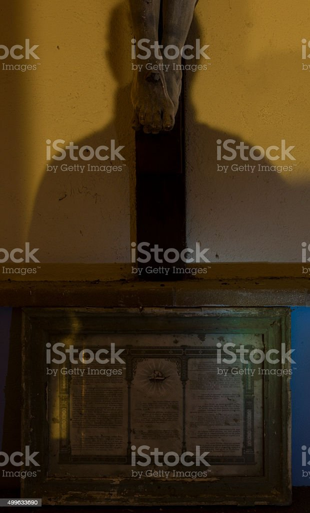 Christ feet kissed by  shadow stock photo