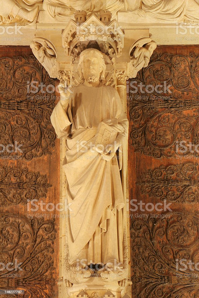 Christ from Notre-Dame portal in Paris royalty-free stock photo