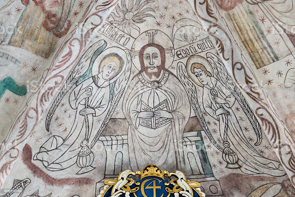 Christ in majesty, a gothic fresco in a Danish church stock photo