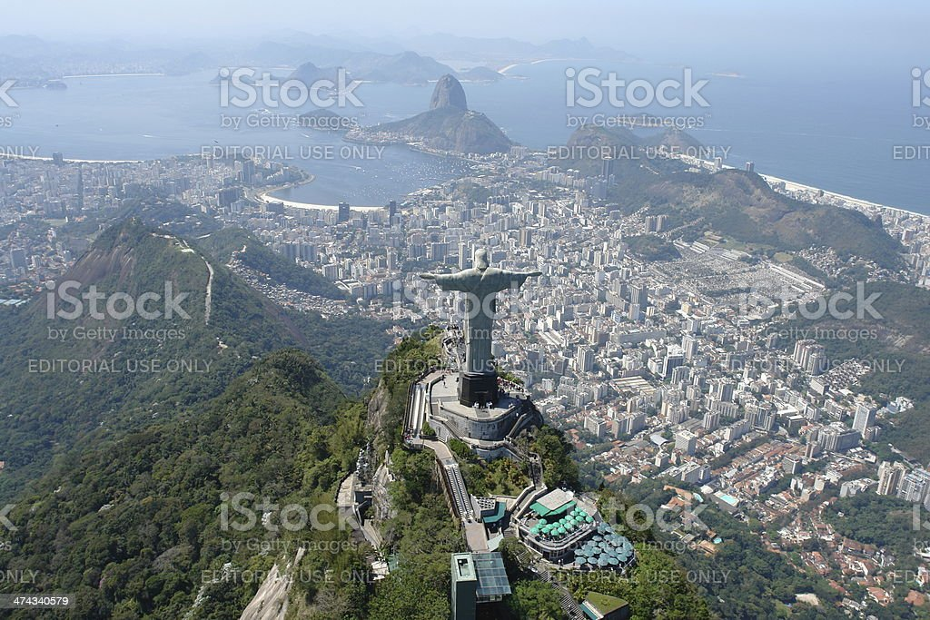 Christ the Redeemer atop the Corcovado hill, facing the Sugarloaf stock photo