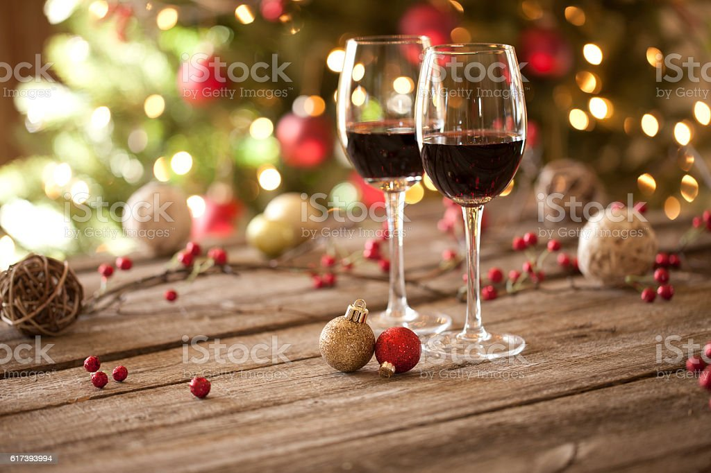 Christams Holiday Red Wine on Wood Table and Christmas Tree stock photo