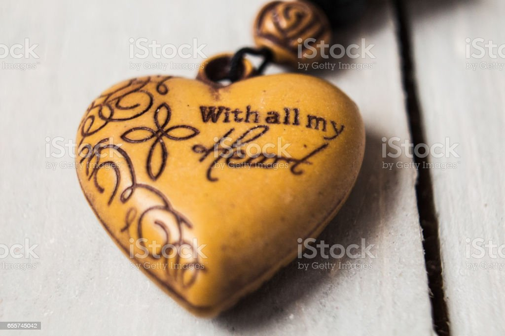 christian charm with message on wooden background stock photo