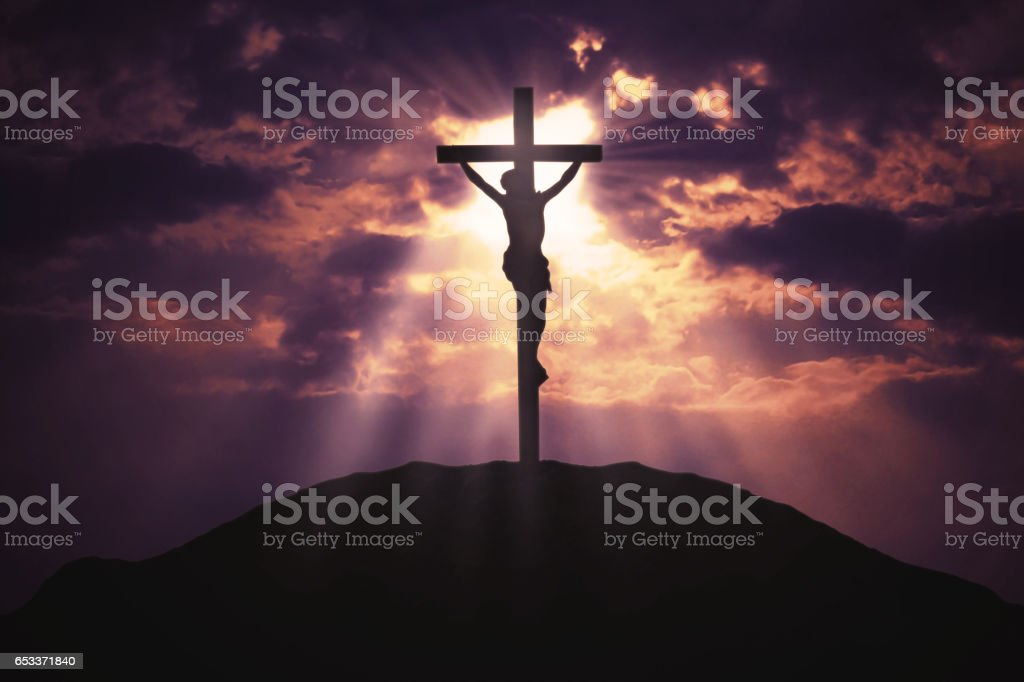 Christian cross on hill at sunrise stock photo