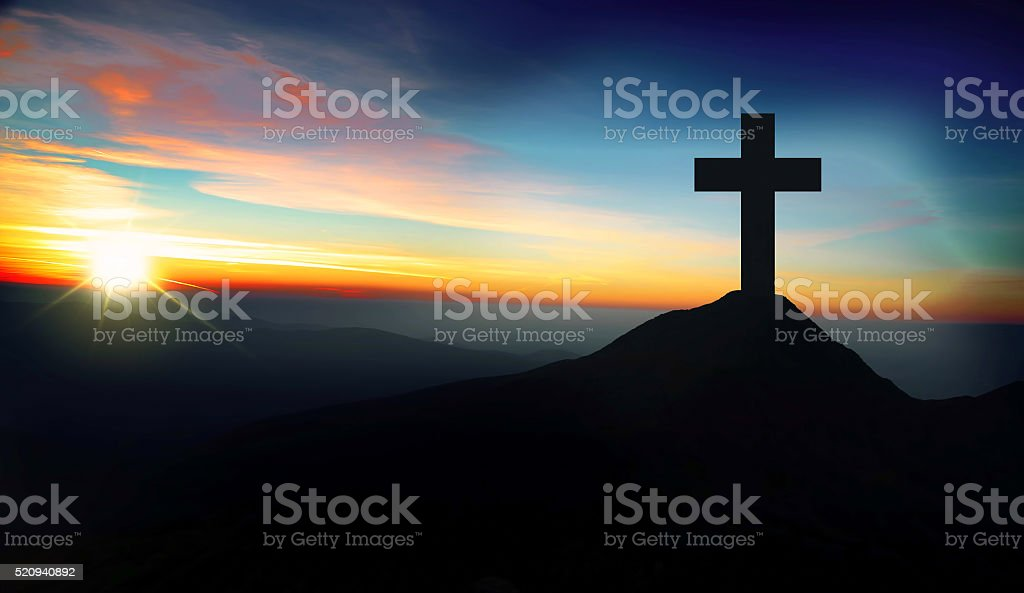 Christian cross on the hill on sunset stock photo