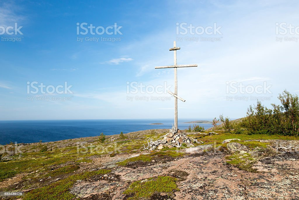 Christian cross on top of the mountain stock photo