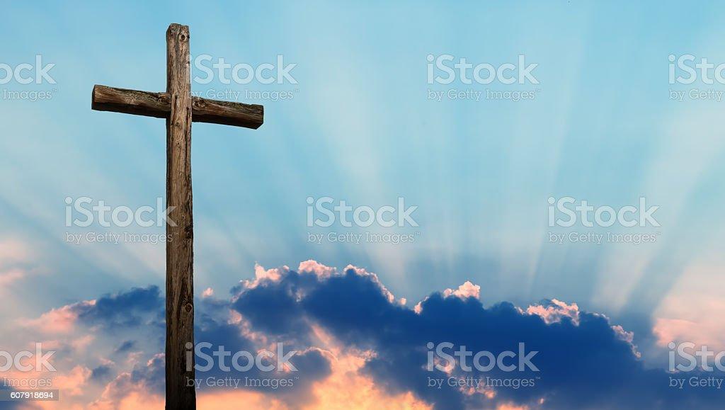 Christian cross over beautiful sky stock photo