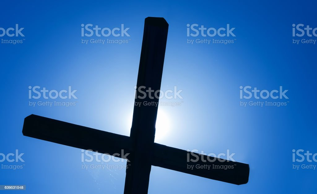 Christian cross over beautiful sunny sky stock photo
