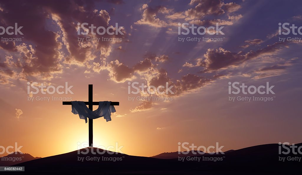 Christian cross over beautiful sunset background stock photo