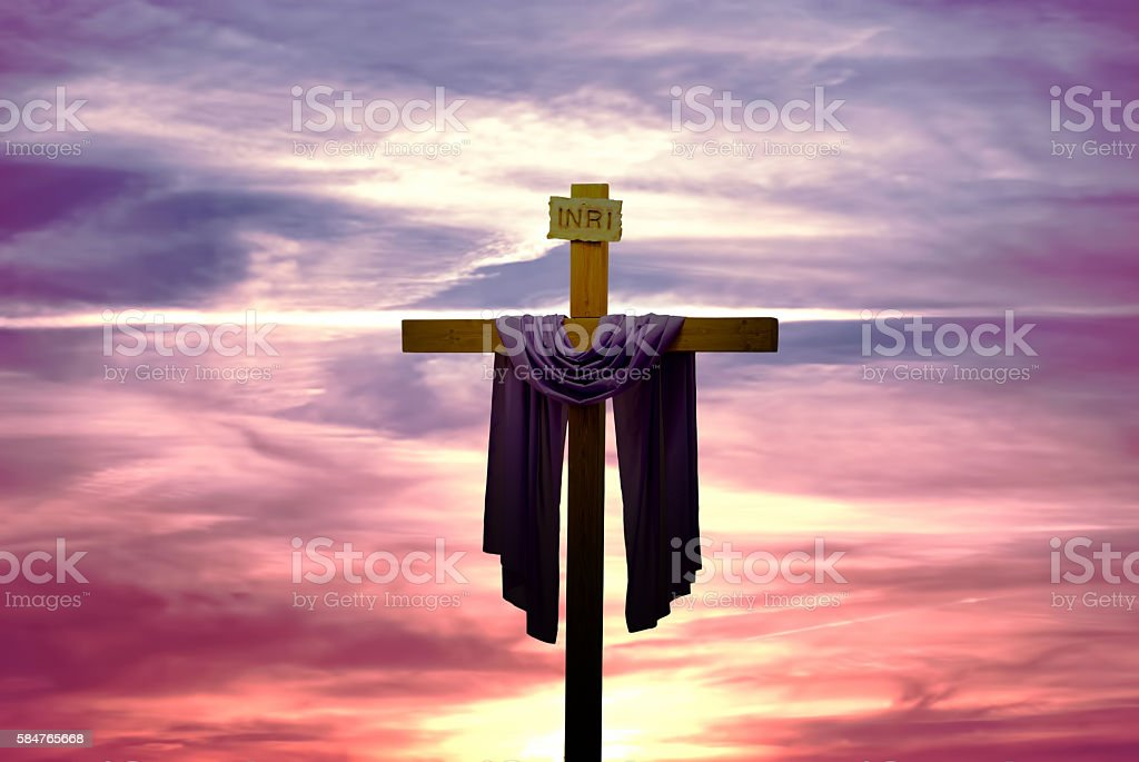 Christian cross over bright sunset background stock photo
