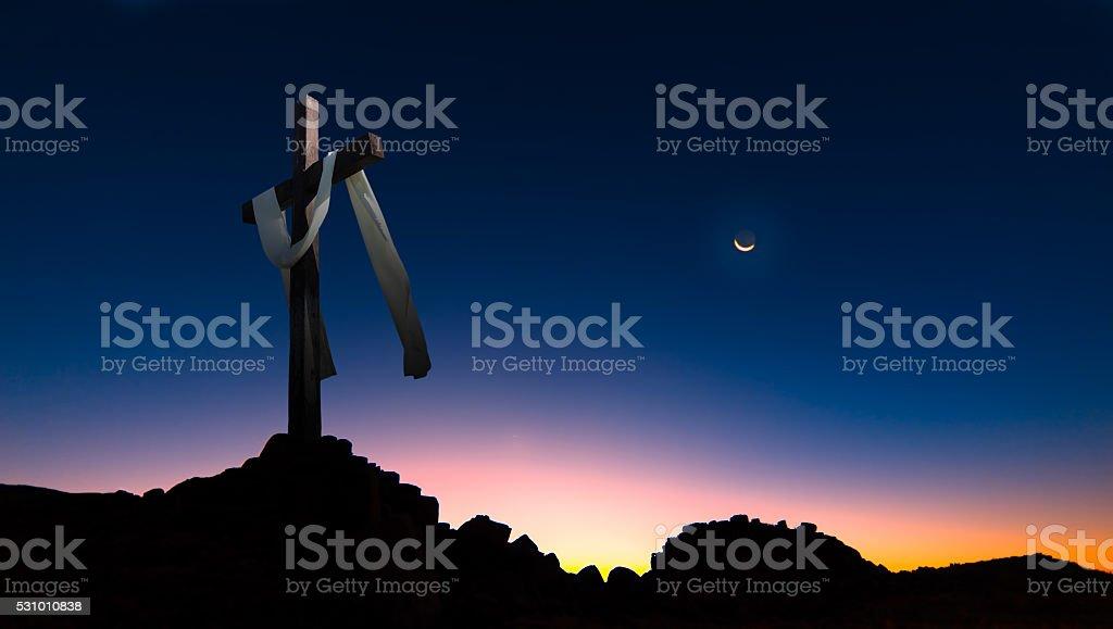 Christian cross over dark sunset background panoramic view stock photo
