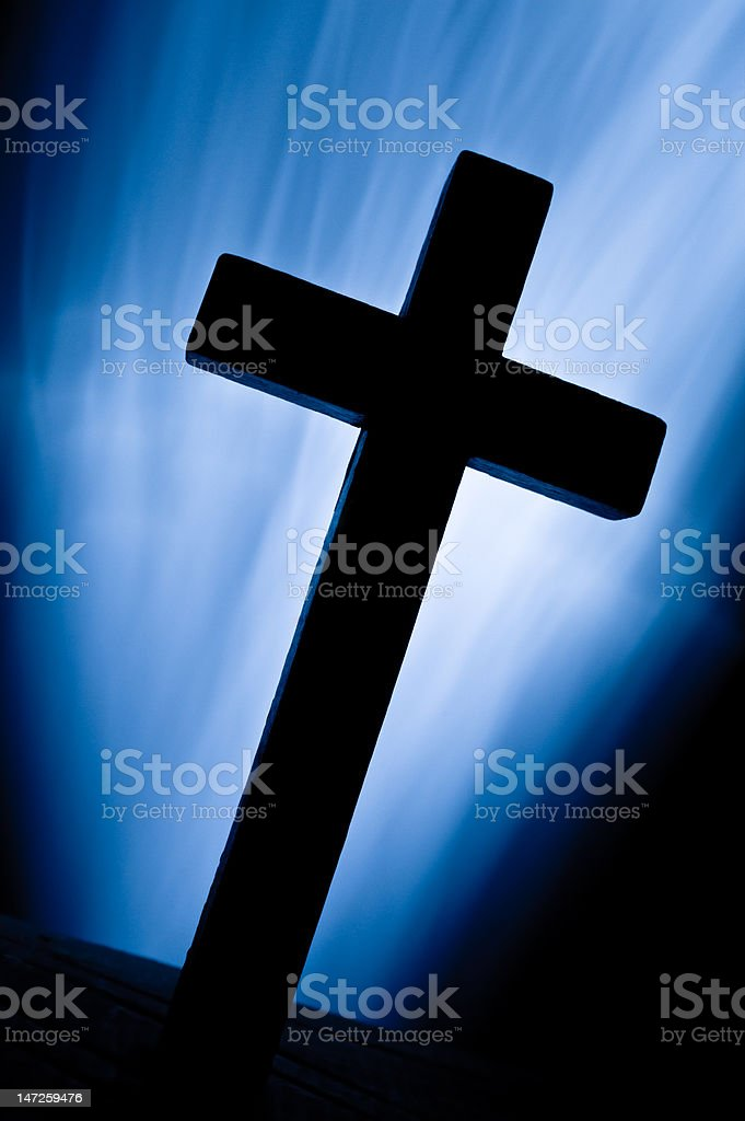 Christian cross over light beams royalty-free stock photo