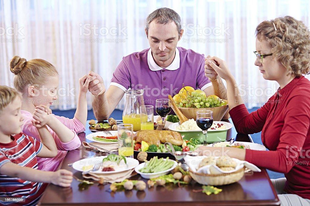 Christian Dinner Praying royalty-free stock photo