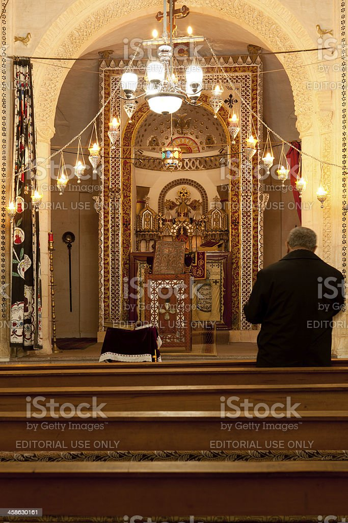 Christian man praying in Mor Barsaumo Syriac Orthodox Church,Midyat stock photo