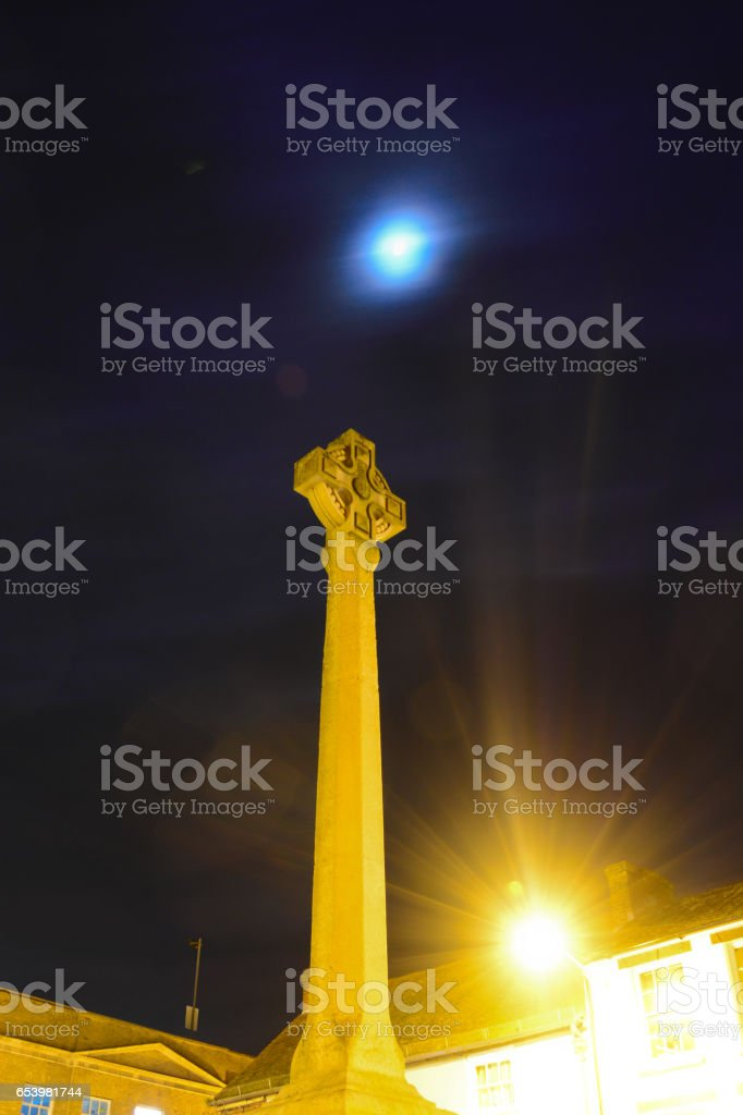Christian Monument and Blue Moon stock photo