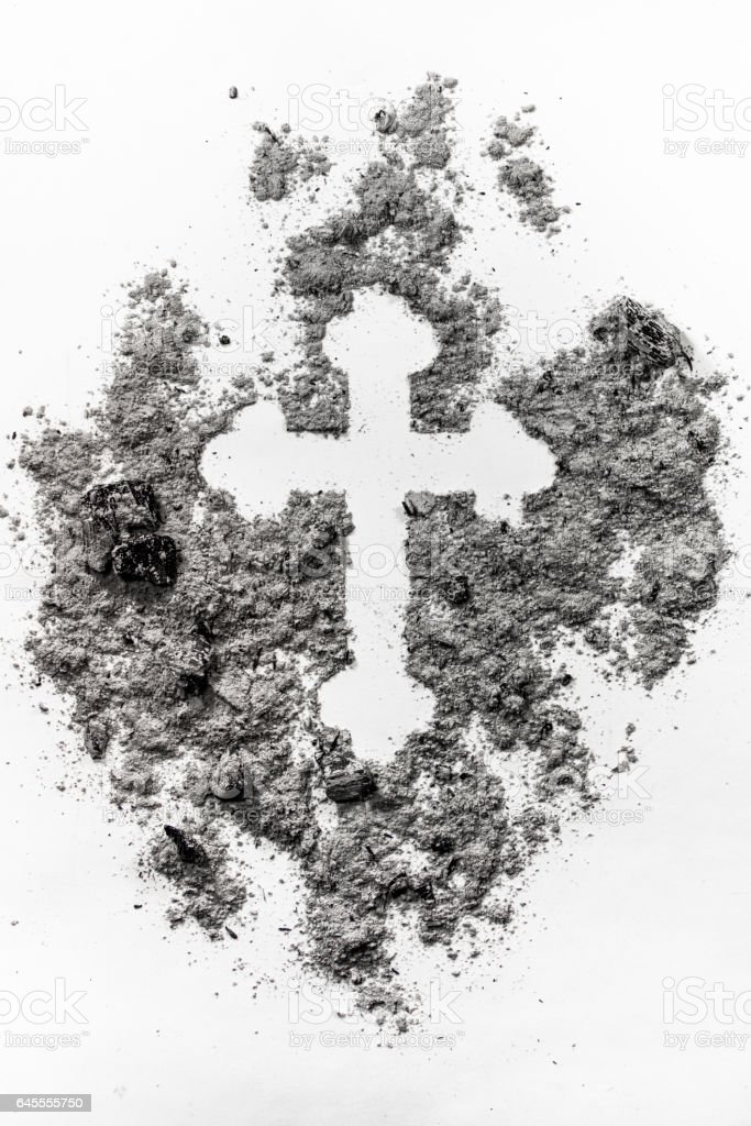 Christian orthodox crucifix sign made in grey ash, dust, dirt as a ash religion, ash wednesday symbol stock photo
