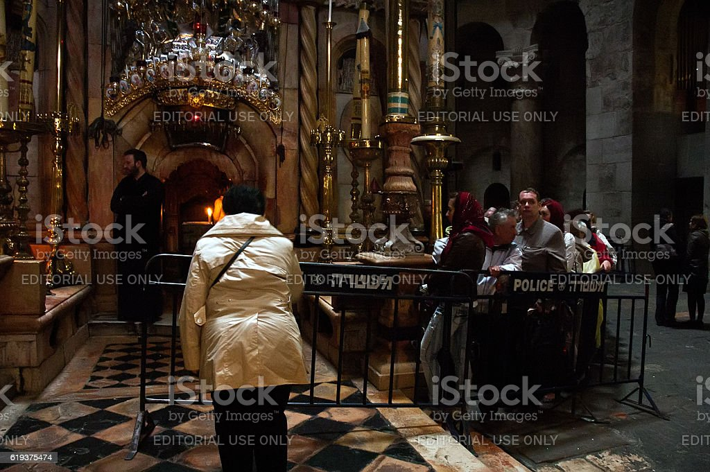 Christian pilgrims prays inside the Church of the Holy Sepulchre stock photo