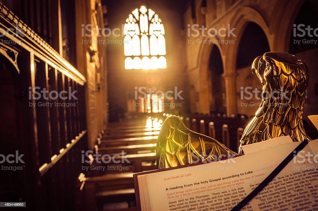 Bible open on an eagle lectern in an English church.