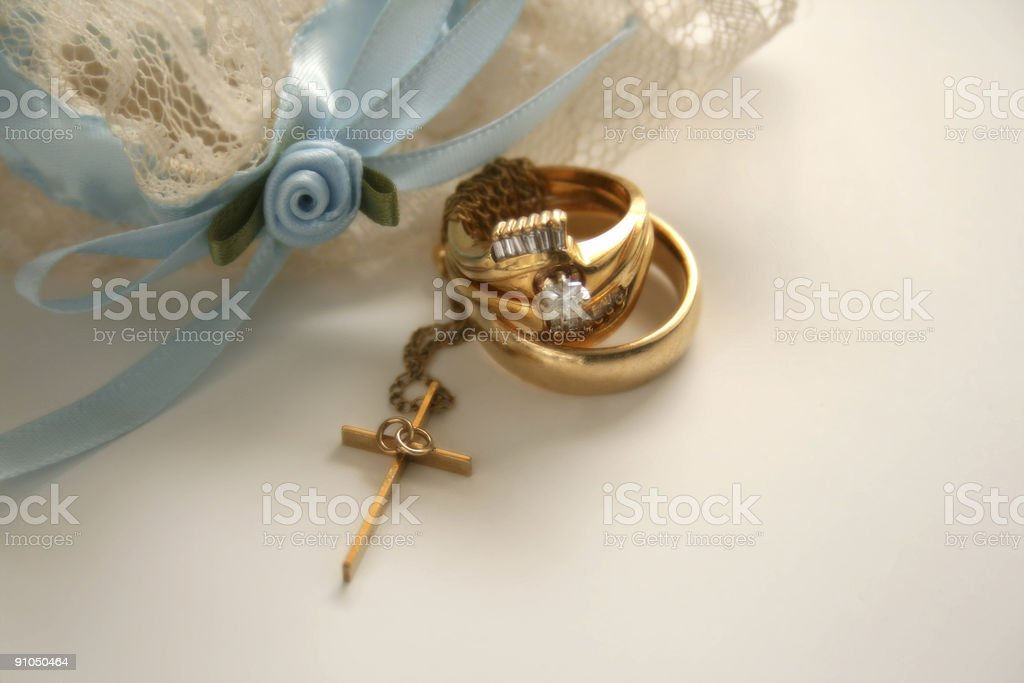 Christian Wedding: Unity Cross and Rings with Blue Garter stock photo