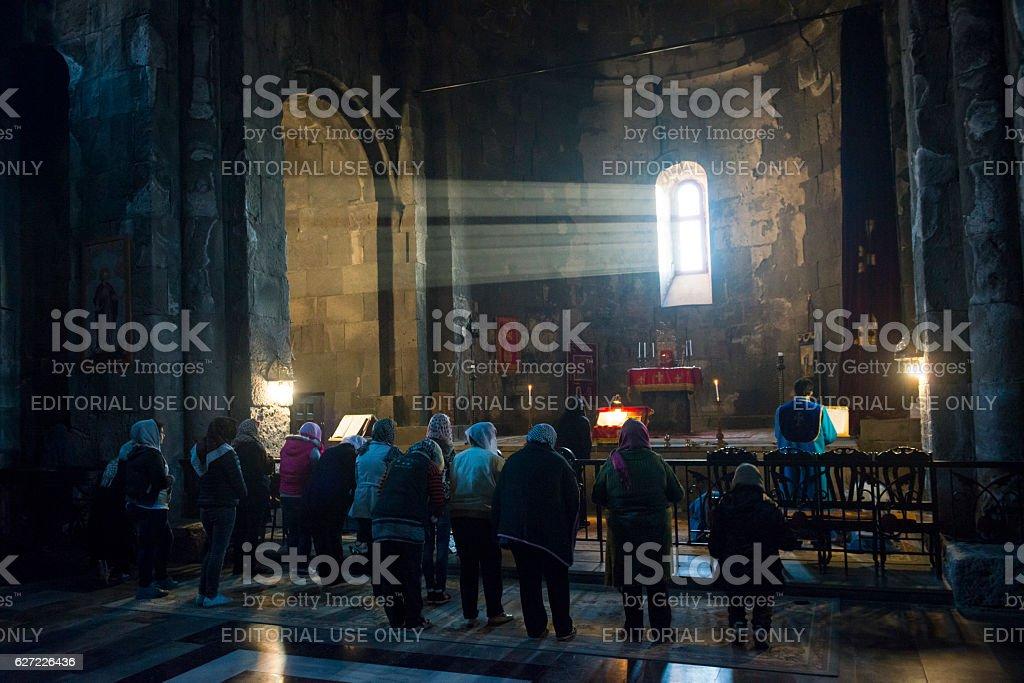 Christian worship at Tatev Monastery in Armenia stock photo