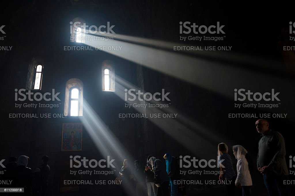 Christians inside Tatev Monastery in Armenia stock photo