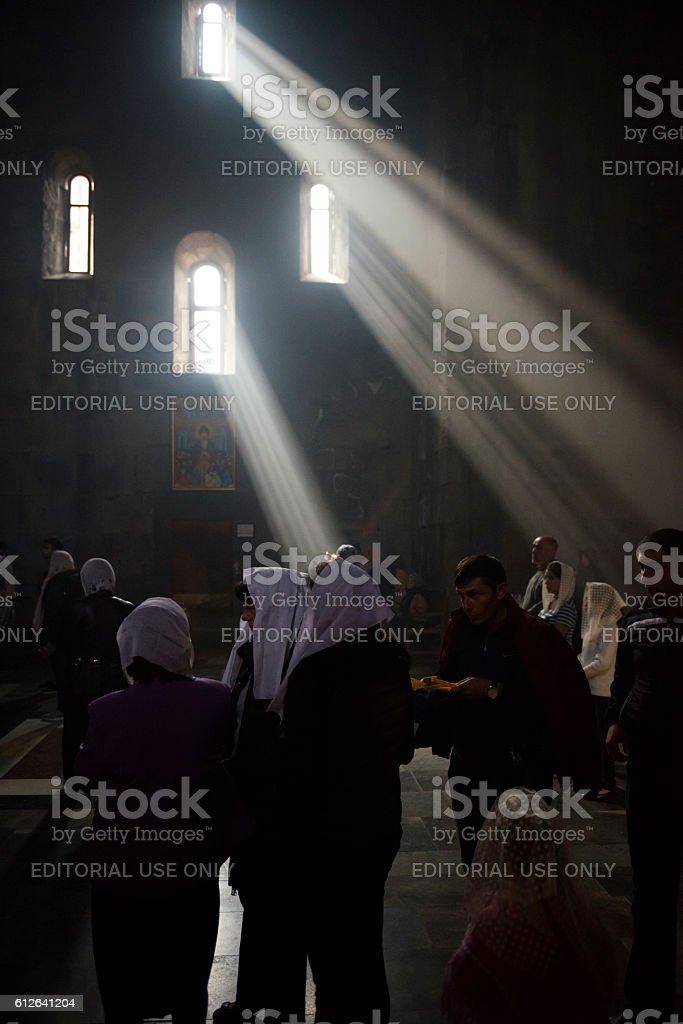Christians inside Tatev Monastery in Armenia stock photo