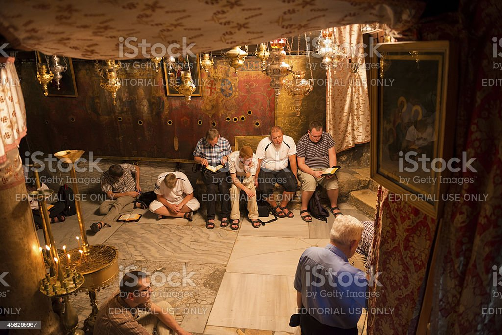 Christians praying at Church of the Nativity in Bethlehe, Palestine royalty-free stock photo