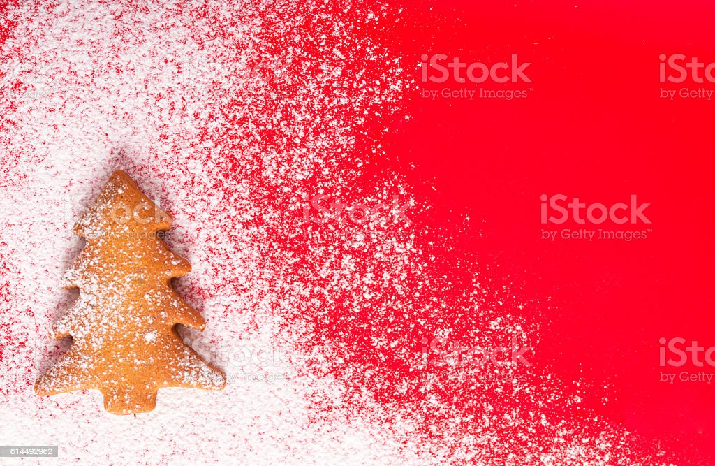 Christmas abstract background on red with Christmas tree cookie stock photo