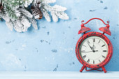 Christmas alarm clock and snow fir tree
