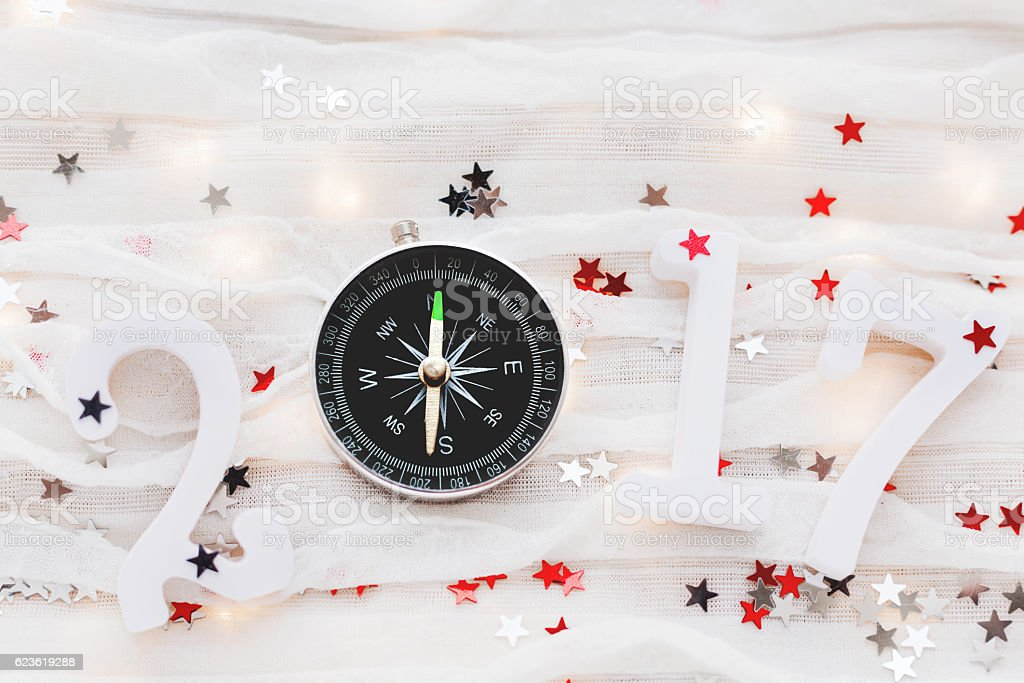 Christmas and New Year 2017 background. Travel symbol - compass, stock photo