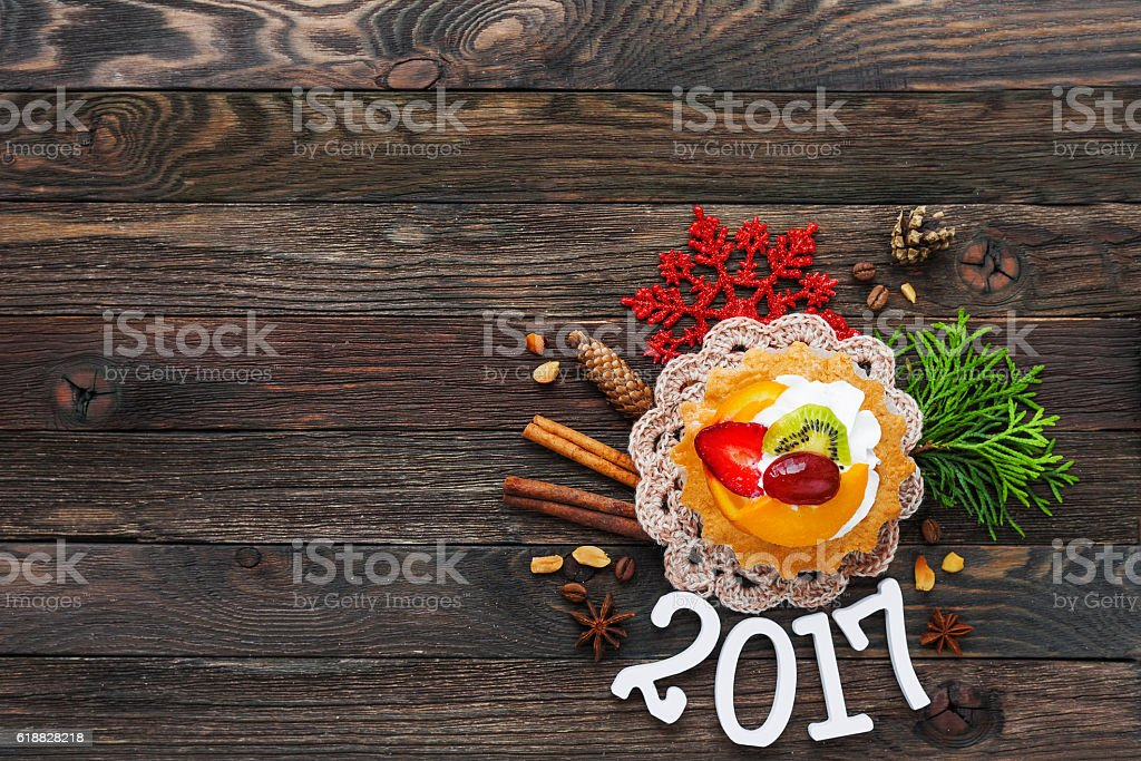Christmas and New Year 2017 background with fruit tart stock photo