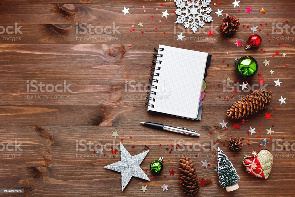 Christmas and New Year background with notepad, pen and decorations. stock photo