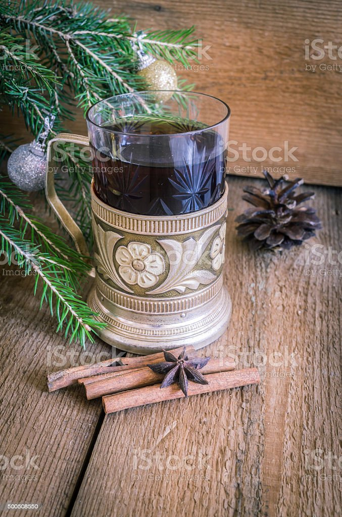 Christmas and new year decoration, tea in glass with coaster stock photo
