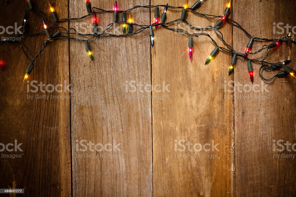 Christmas and New Year lights on old wood background stock photo
