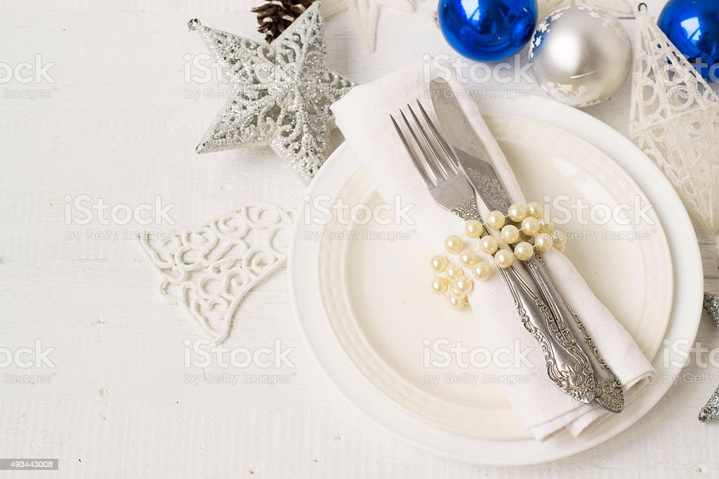 Christmas and New year table place setting with christmas decora stock photo