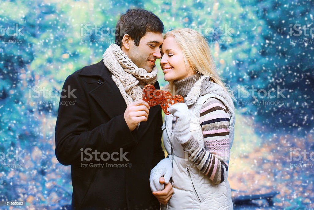 Christmas and people concept - happy pretty young couple stock photo