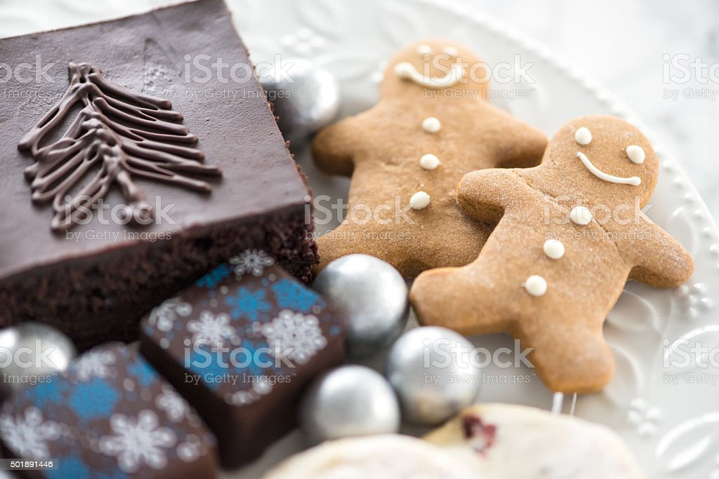 Christmas and Winter Desserts, Chocolates, Candy on White Holly Plate stock photo