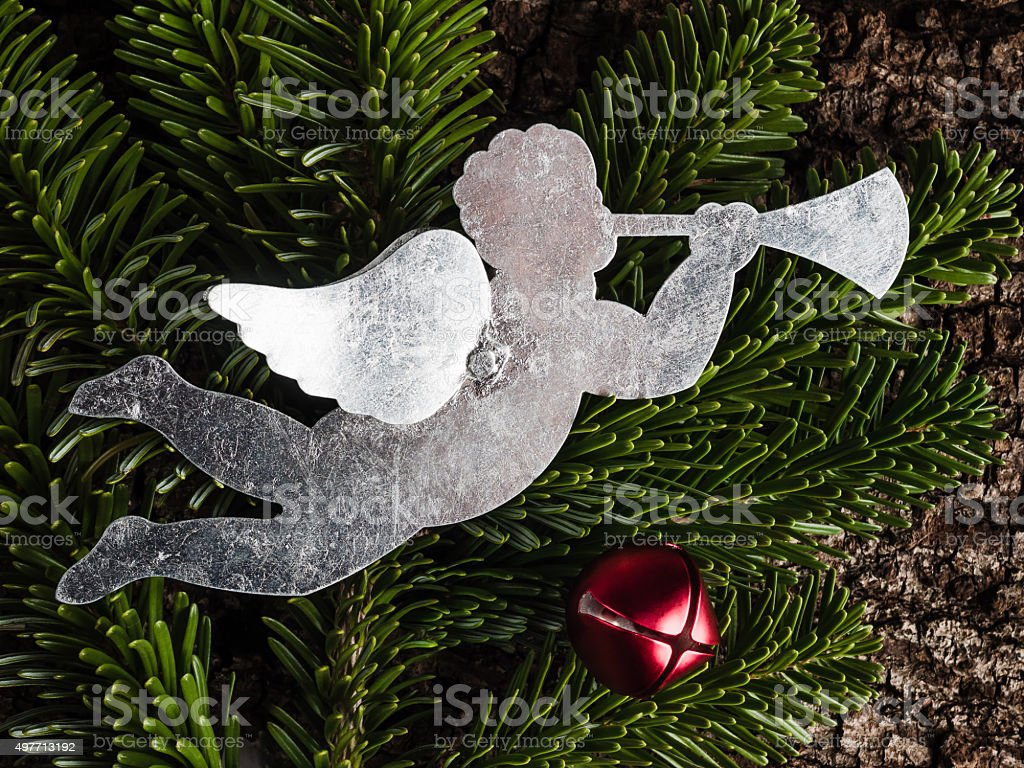 Christmas angel, evergreens, bell and bark stock photo