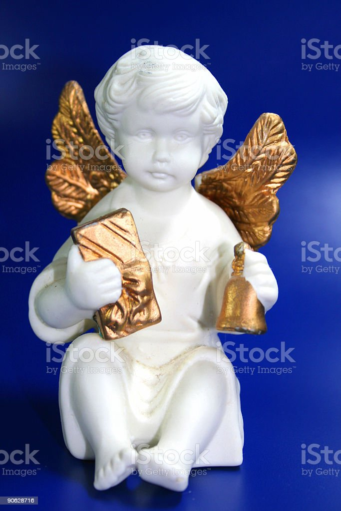 christmas angel with bell and present in hands stock photo