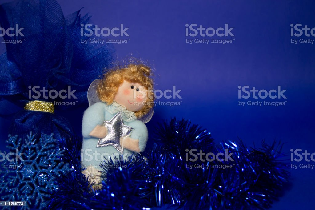 Christmas angel with blue gliiter  decoraition,greeting card stock photo