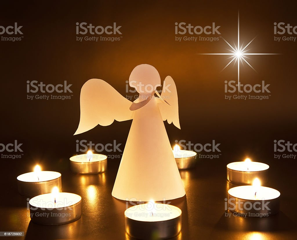 Christmas angel with candles stock photo