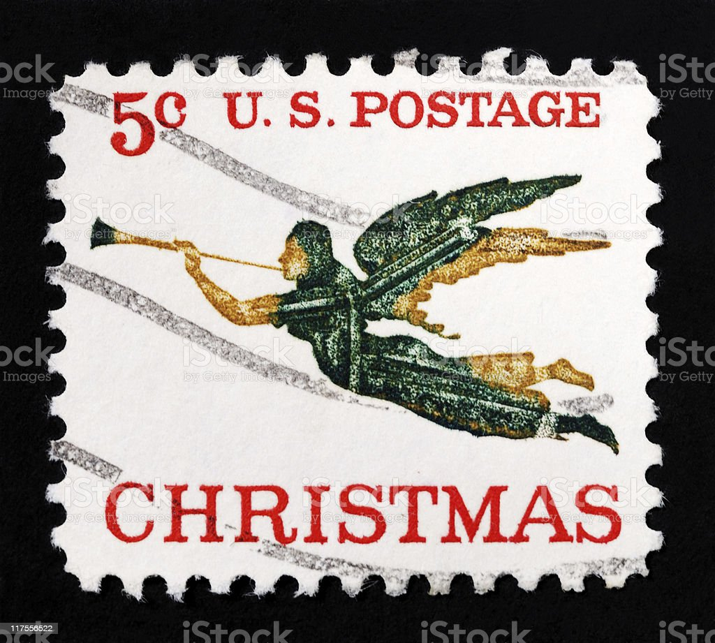 Christmas angel with horn stamp royalty-free stock photo