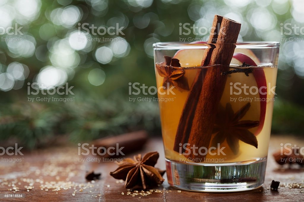 Christmas apple cider with spices cinnamon, cloves, anise and honey stock photo