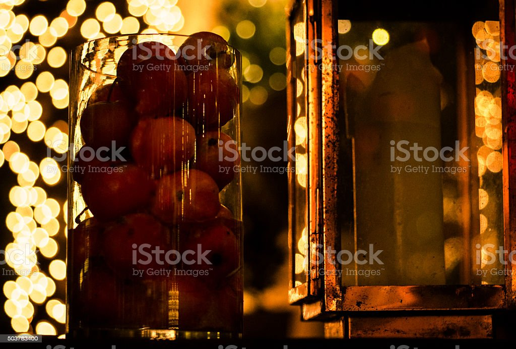 Christmas Apples and candlelight stock photo