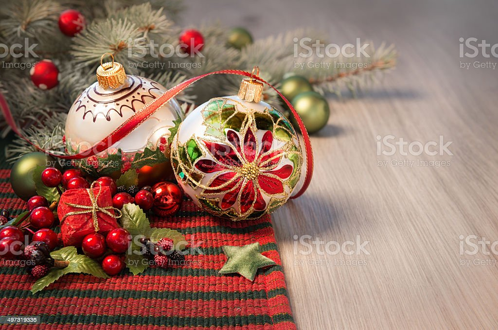Christmas arrangement in red and green on wood, text space stock photo