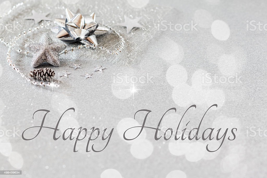 Christmas arrangement with decorations, silver, english wishes stock photo