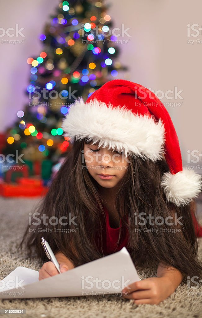 Christmas Asian Child Writing a Letter to Santa Claus stock photo