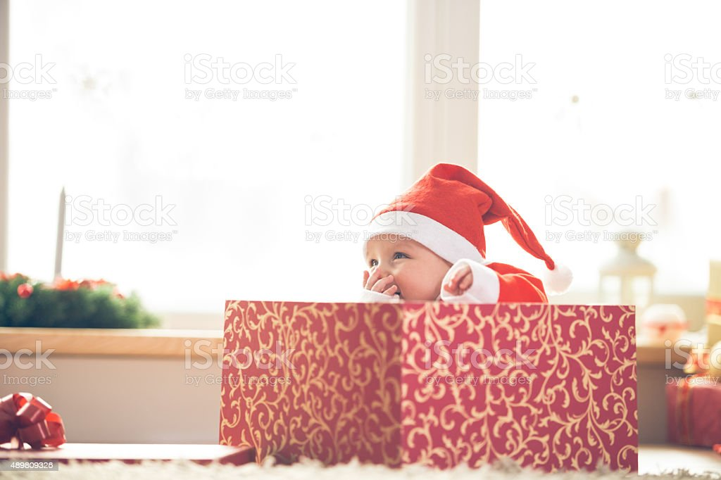 Christmas baby in a gift box stock photo