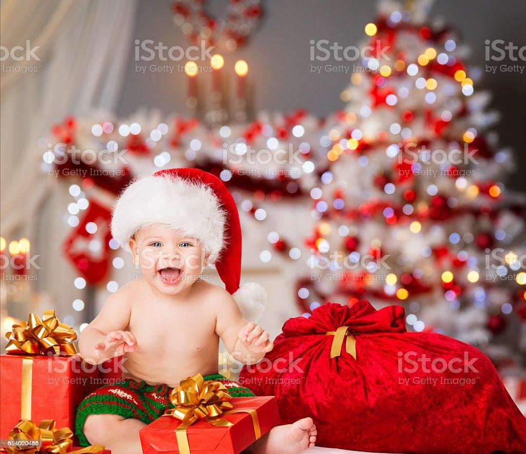 Christmas Baby Santa Hat, Kid Boy, Present Gift and Bag stock photo
