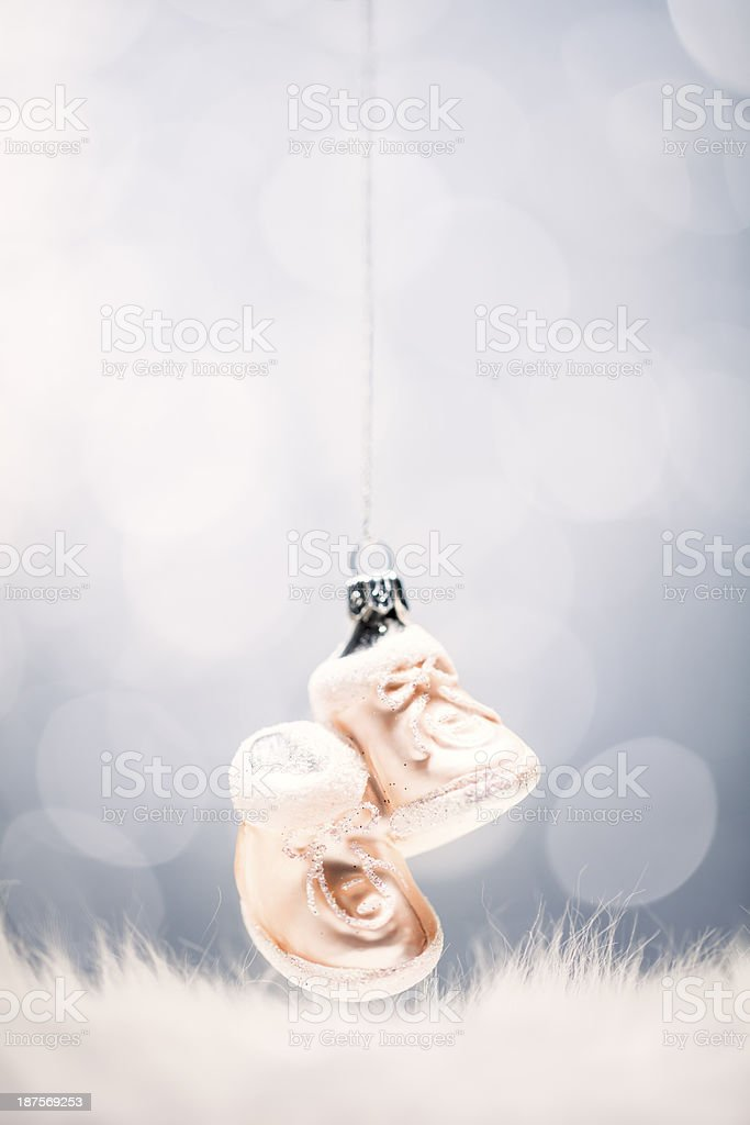 Christmas Baby Shoes - Humor Fun Cute Bauble Card Background royalty-free stock photo