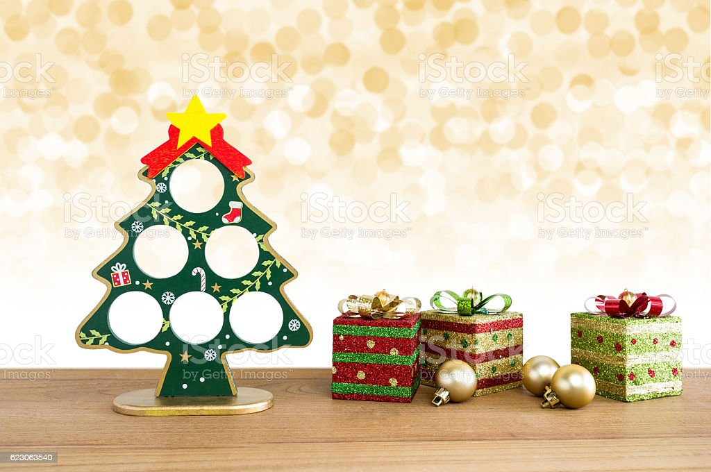 Christmas background. Christmas tree, golden balls and gift boxe stock photo